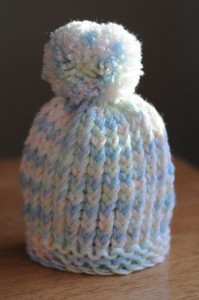 Photo of Loom Knit Puff Ball Infant Hat